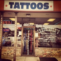 Photo taken at Inkslinger's Tattoo Studio by Michael H. on 8/8/2013