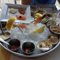 Photo taken at Fin Restaurant & Raw Bar by Sat E. on 6/5/2013