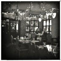 Photo taken at La Taverna Bar & Restaurant by Claudio A. on 1/11/2013