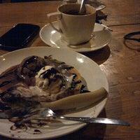Photo taken at Kongkow Cafe by Cynthia C. on 3/27/2014
