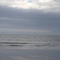 Photo taken at Charmouth Beach by Jasper Z. on 7/13/2017