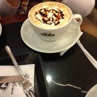 Photo taken at Caffè Nero by Dilek G. on 11/17/2012