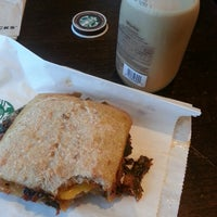 Photo taken at Starbucks by Adrian R. on 7/8/2014