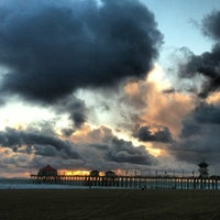 Photo taken at Huntington Beach Pier by Curt E. on 2/13/2013