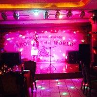 Photo taken at Around the World by Carmen J. on 11/25/2014
