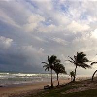 Photo taken at Praia de Ipitanga by Beatriz L. on 10/12/2012