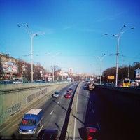 Photo taken at Зупинка «Станція метро «Дорогожичі» by Lelia Z. on 11/21/2014