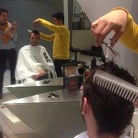 Photo taken at Ken Hair Studio by Mau T. on 12/20/2014