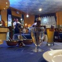 Photo taken at Mezbaan Bar & Indian Cuisine by Aaron D. on 12/5/2013