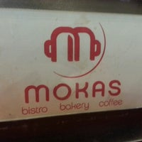 Photo taken at Mokas Coffee by Jarrod B. on 3/30/2013