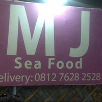 Photo taken at MJ Seafood by Tri A. on 2/25/2014