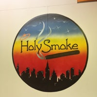 Photo taken at Holy Smoke Cafe by Lorena R. on 10/10/2012