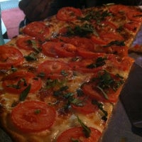 Photo taken at Oggi's Pizza & Brewing Company by Marina A. on 10/20/2012