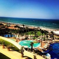 Photo taken at Mövenpick Resort & Marine Spa Sousse by Misha F. on 7/26/2013