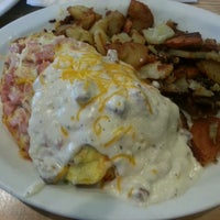 Photo taken at Louie's Grill Fusion Restaurant by Ben T. on 6/16/2013