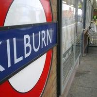 Photo taken at Kilburn London Underground Station by Sahan B. on 11/21/2012