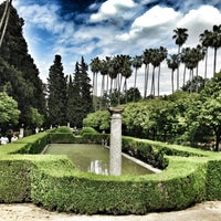 Photo taken at Jardines de los Reales Alcázares by Anna B. on 4/30/2013