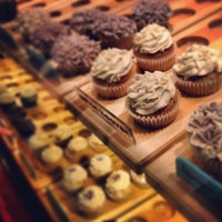 Photo taken at The Divine Cupcake by Xuan V. on 12/14/2012