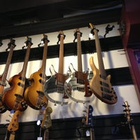 Photo taken at Gruhn Guitars by Patrick M. on 3/13/2013