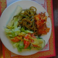 Photo taken at Mandarin Chinese Restaurant by Courtney M. on 12/20/2012