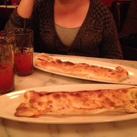 Photo taken at Calzone's Pizza Cucina by Kirsten S. on 11/25/2012
