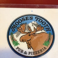 Photo taken at Moose's Tooth Pub & Pizzeria by Scott M. on 10/24/2012