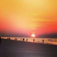 Photo taken at Coligny Beach by Adam on 5/23/2014