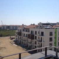 Photo taken at Olympic Village by Roman F. on 6/29/2013