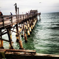 Photo taken at Cocoa Beach Pier by Gerald L. on 12/25/2012