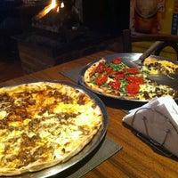Photo taken at Atolinni Pizzaria by Jackson J. on 6/27/2013