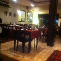 Photo taken at Atolinni Pizzaria by Jackson J. on 10/16/2012