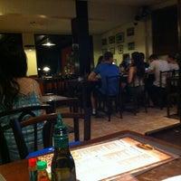 Photo taken at Atolinni Pizzaria by Jackson J. on 1/6/2013