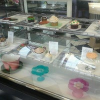 Photo taken at Mad Hatters Cupcakes by Tina S. on 12/14/2012