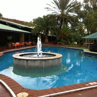 Photo taken at Chifley Alice Springs Resort by Rosina L. on 5/21/2013