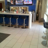 Photo taken at Delta Sky Club by Mark R. on 10/24/2012