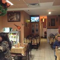 Photo taken at El Meson de Yully by Orlando S. on 11/25/2012