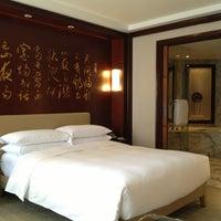 Photo taken at Grand Hyatt Shanghai by John K. on 5/29/2013