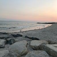 Photo taken at Rockaway Beach by Andy C. on 8/26/2017