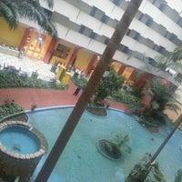 Photo taken at Sheraton Abuja Hotel by özge on 3/6/2013