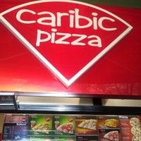 Photo taken at Caribic Pizza by Mirela H. on 5/25/2013
