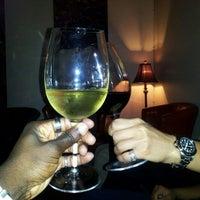 Photo taken at District Wine by Jai K. on 1/28/2013