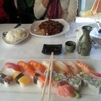 Photo taken at Axia Restaurant & Bar by Sergei Z. on 11/25/2012