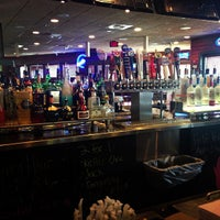 Photo taken at Smokey Bones Bar & Fire Grill by George F. on 5/17/2013