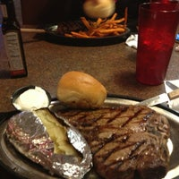 Photo taken at Ole's Big Game Steakhouse by Michael C. on 3/30/2013