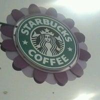 Photo taken at Starbucks by Camila B. on 12/30/2012