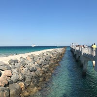 Photo taken at South Pointe Pier by Laura C. on 5/8/2017