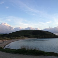 Photo taken at Daymer Bay by Cynthia D. on 10/6/2013