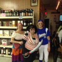 Photo taken at Village Bar and Liquors by Mary G. on 11/25/2013