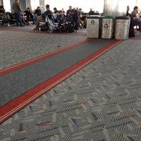 Photo taken at Gate B16 by Jennifer M. on 11/3/2012