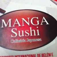 Photo taken at Manga Sushi by Romulo S. on 12/21/2012